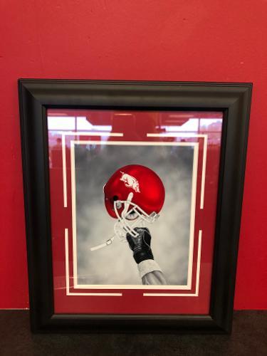 Arkansas Razorbacks Helmet in Air Framed Print